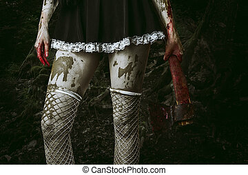 Dirty womans hand holding a bloody ax - Halloween horror...