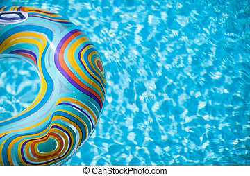 Colorful pool float in blue swimming basin - Colorful pool...