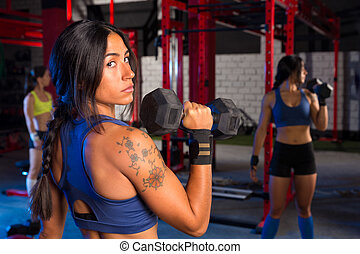 Gym women with hex barbell workout exercise