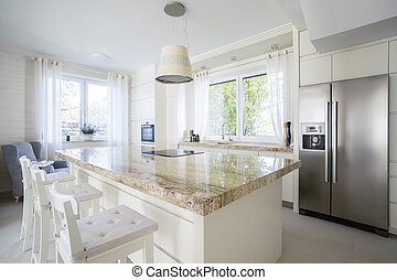 Kitchen island in bright house - View of kitchen island in...