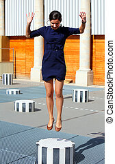 Free Happy Woman jumping on top of the column