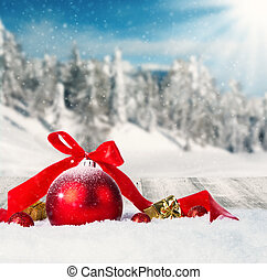 Winter scenery with christmas ball - Snowy winter landscape...