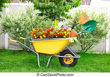 Garden tools - Wheelbarrow with shovel and rake in a...