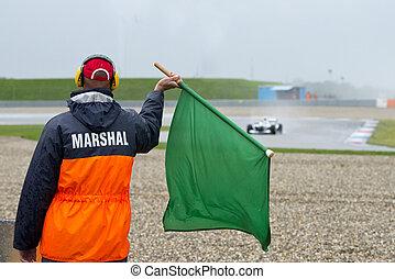 Marshal waving a green flag - Safety steward marshal waving...