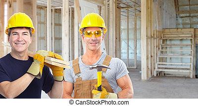 Handyman with a hammer. House renovation.