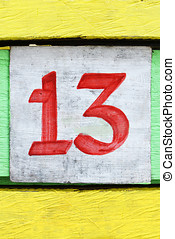 Thirteen - Number thirteen painted on an old colored wood
