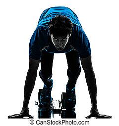 man runner sprinter on starting blocks silhouette - one man...