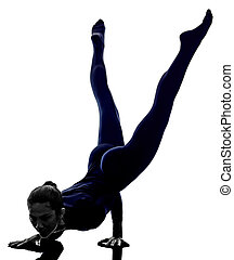woman exercising Mayurasana peacock pose yoga silhouette