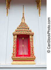 Ancient Gold carving wooden window of Thai temple