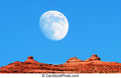 Monument Valley - A Large moon over Monument Valley Arizona