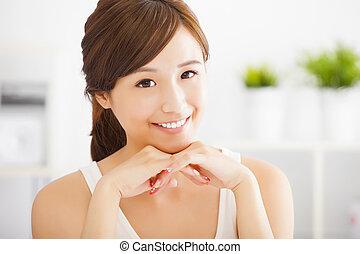 close up of beautiful and smiling  asian young woman at home
