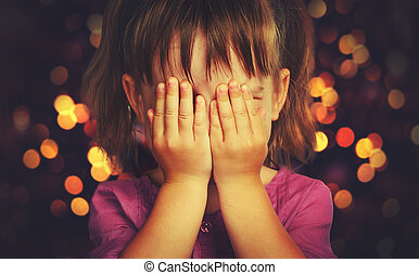 little girl in anticipation of a Christmas miracle and a...