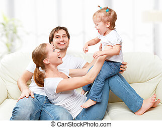 Happy family mother, father, child baby daughter at home on...