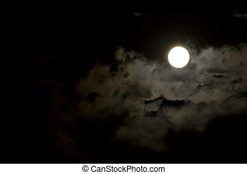moon on the night sky - Image of the clouds and moon in the...