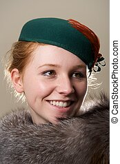 Smiling redhead in green hat looking up