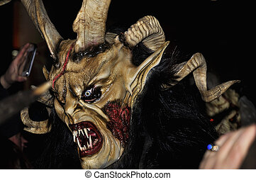 Devil mask. - RETZ, AUSTRIA - DECEMBER 7: Unidentified man...