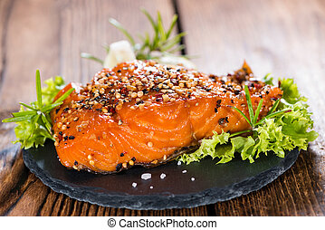 Portion of Smoked Salmon marinated with fresh herbs and...