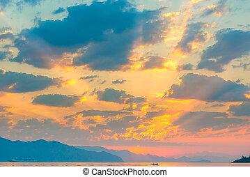 beautiful cumulus clouds over the sea at sunrise