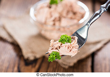 Tuna on a fork - Portion of tuna (with parsley) on a fork as...