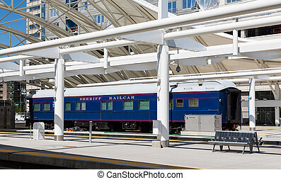 Sheriff Railcar in Denver - A blue and white Sheriff's...