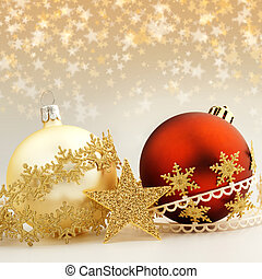 christmas baubles and decorative ribbons on starry...