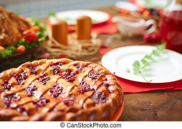 Crostata - Homemade pie with cowberry jam on festive table