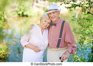 Amorous seniors - Happy senior couple in smart casual...