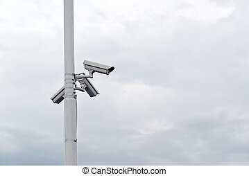 Security cameras on the post - Security CCTV cameras mounted...