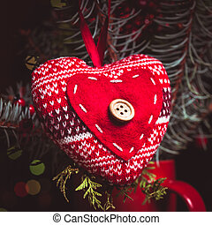 Handmade knitted heart - christmas decoration on the fir...