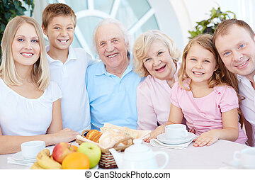 Family dinner - Portrait of happy big family of six having...