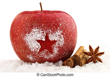 christmas apple - decorated red apple and spices in the snow