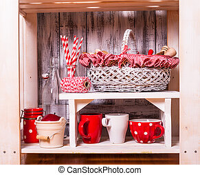 Shelves in the rack in the kitchen at shabby chic style