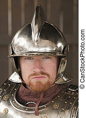 knight in closeup - Young bearded Knight in shining armor