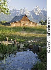 Old Mormon Barn against the tetons - iconic scene of old...