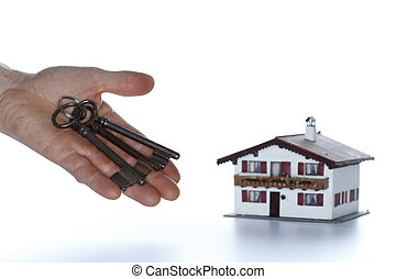 house purchase - symbolic house purchase with hand and keys