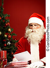 Misunderstanding - Santa Claus reading wish letter and...