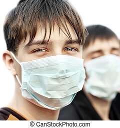 Teenager in Flu Mask - Two Teenagers in the Flu Mask on the...