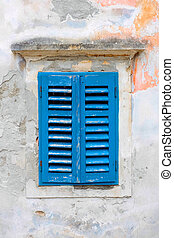 Blue shutters - Old window with blue shutters