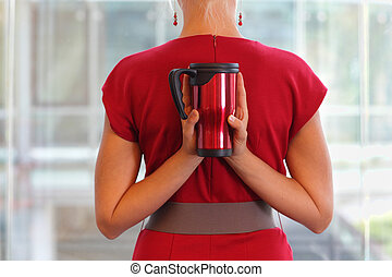woman with thermal cup