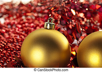 Two Christmas baubles - Two golden Christmas baubles and...
