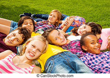 Group of children laying together and smile - Group of...