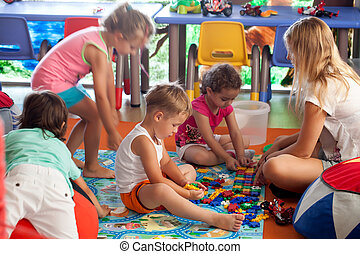 Children playing games in nursery - Group of children and...
