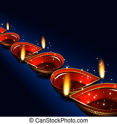 diwali oil lamps over dark blue background with place for...