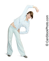 Smiling girl doing aerobics over white background - Young...