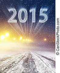 winter road to 2015 - Snow covered winter way leading in new...