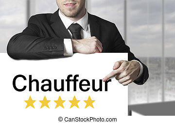 businessman pointing on sign chauffeur - businessman in...