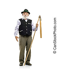 Old man with flail isolated - Old bearded bavarian man in...