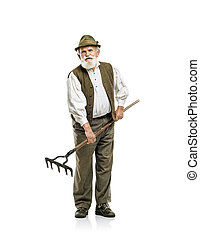 Old man with rake isolated - Old bearded bavarian man in hat...