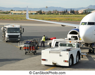 Loading suitcases and other cargo in an airplane