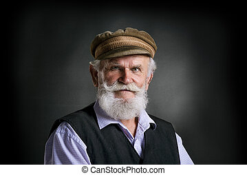 Old man in cap on black background - Portrait of old bearded...